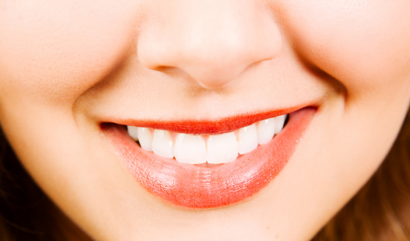 Why Do Orange Shades of Lipstick Make Your Teeth Look Unhealthy?