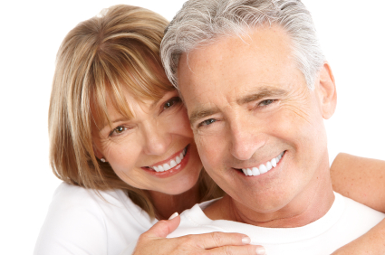 Smiling couple after gatting Restorative Dentistry by their Lacey dentist at Brian K. Rounds, DDS.